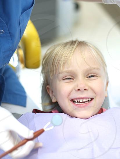 Happy patient in the dentist practice photo