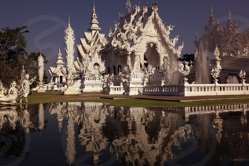 the Wat Rong Khun temple near of the city of Chiang Rai in the north provinz of chiang Rai in the north of Thailand in Southeastasia. photo