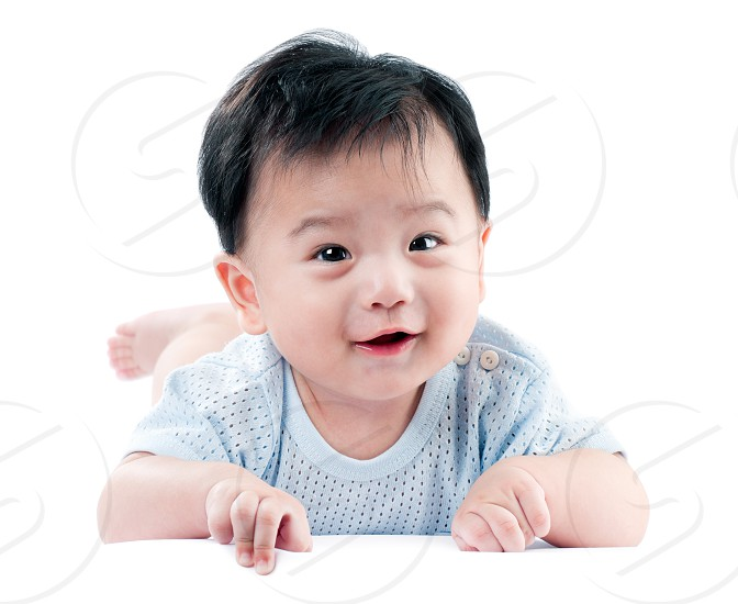 Portrait of a happy smiling infant baby crawling on white background. photo