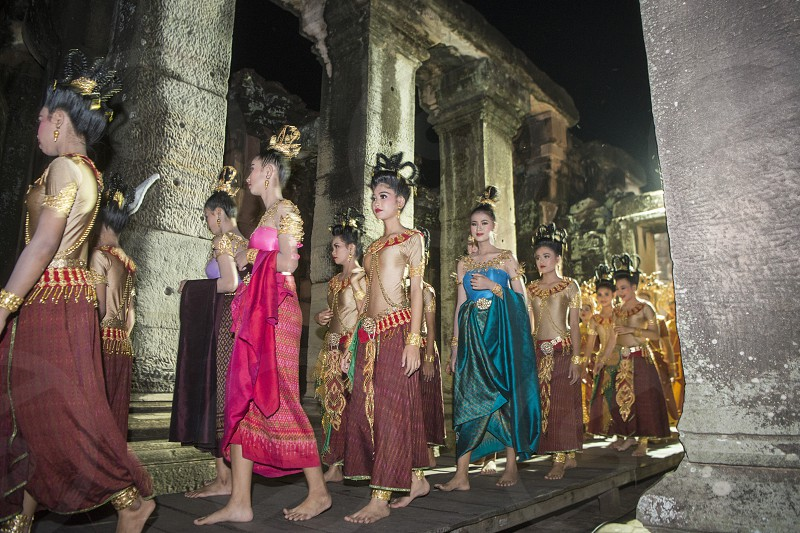 traditional dress Khmer dance girls at the Khmer Temple Ruins at the Phimai Festival in  Phimai in the Provinz Nakhon Ratchasima in Isan in Thailand.  Thailand Phimai November 2017 photo