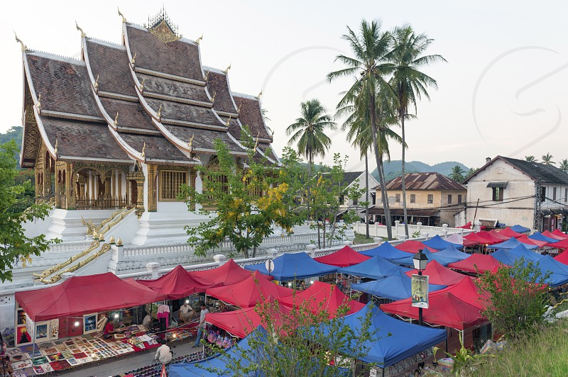 Luang Prabang Night Market popular tourist venue for souvenirs and handicraft products located on main street in central area in front of the Royal Palace Museum in the UNESCO World Heritage town of Lao PDR. photo