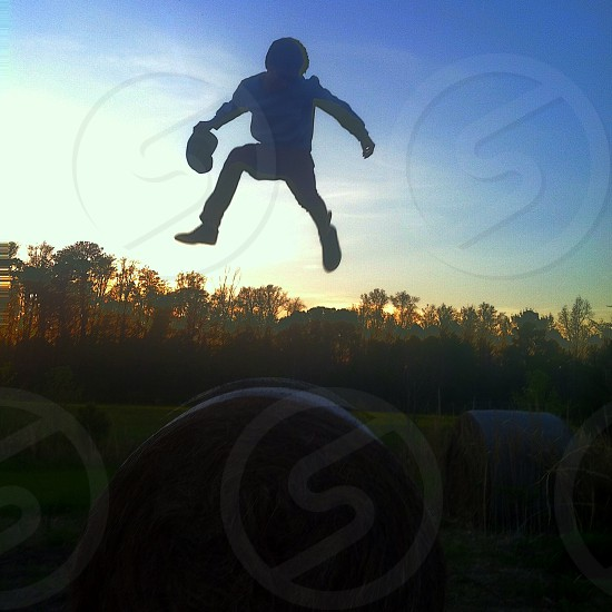 boy in blue t shirt jumping photo