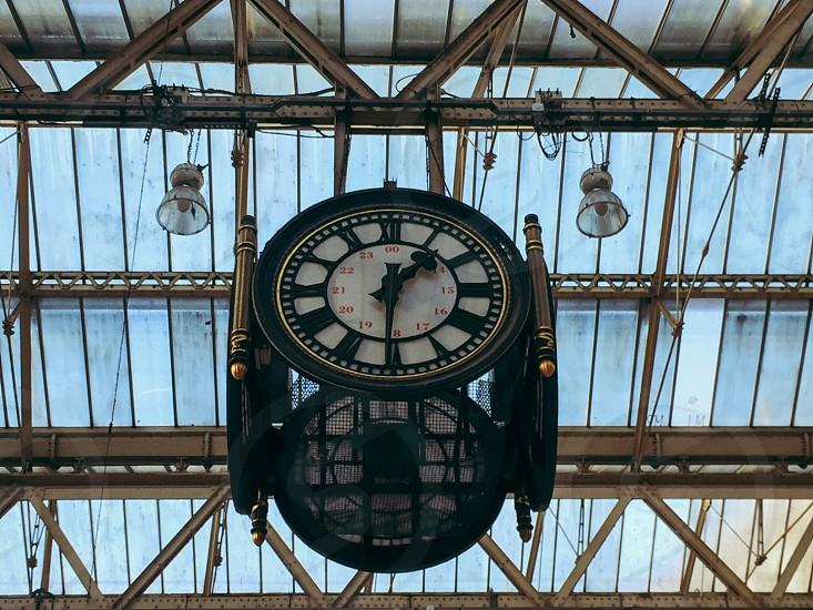 black metal analog clock photo