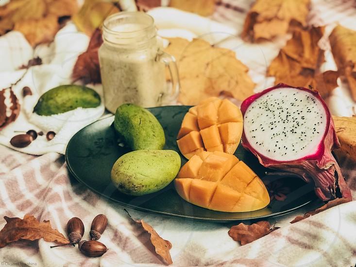 Fruits mango exotic wellness food flat lay food stilist  photo