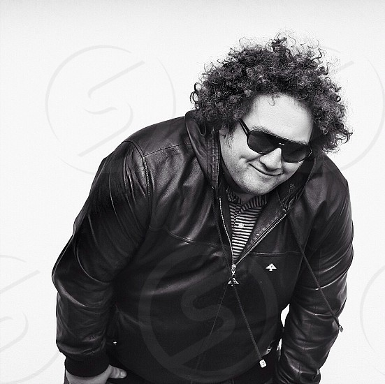 man wearing black zip up leather jacket photo
