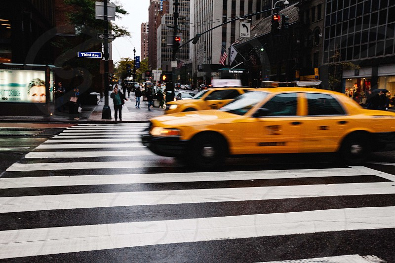 yellow taxi can on pedestrian lane photo