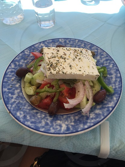 tofu with sliced vegetables on white and blue plate photo