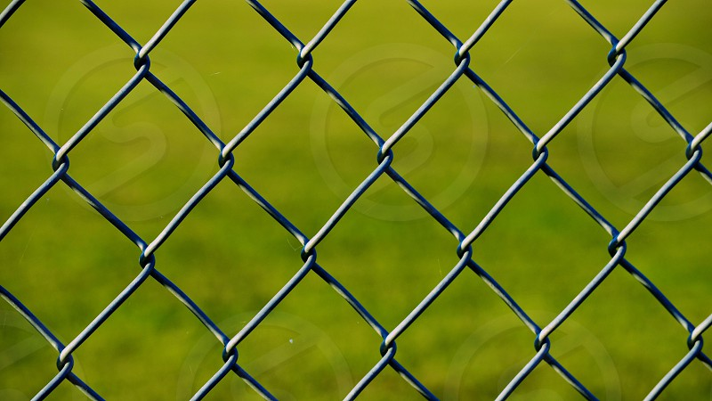 silver metal fence photo