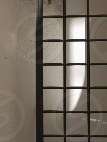 Light reflections and pattern of back gate Rome Italy. photo