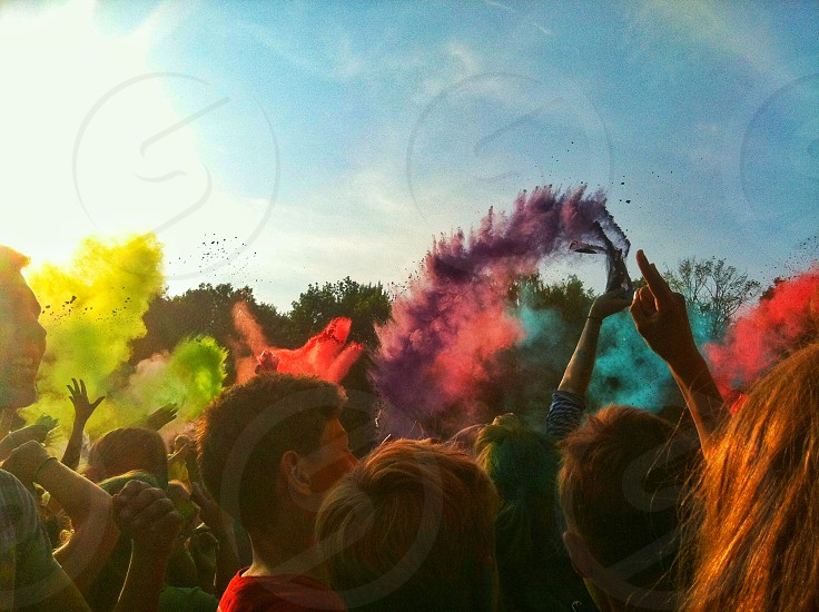 Young people throwing colorful powder on Holi fectival. photo