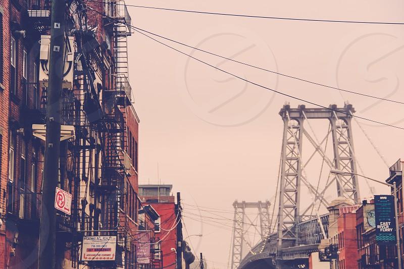 silver metal bridge in the city photo