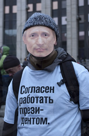 """The protester with Putin's mask on his face and inscription on his t-shirt: """"I am ready to work as a President"""". The biggest protest in Russia for the last 20 years. December 24 2011 Moscow. photo"""