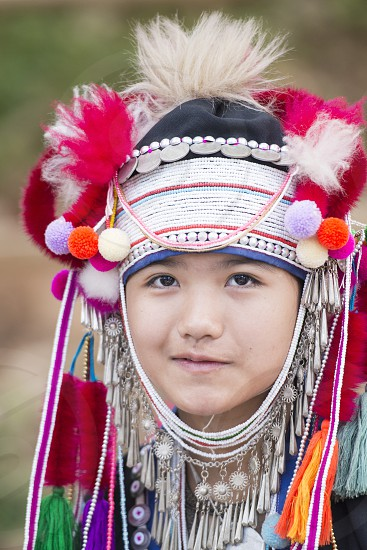 a Ahka hill Tribe Girl at the Mae Fah Luang ornamental garden at the village of  Doi Tung north of the city of Chiang Rai in North Thailand. photo