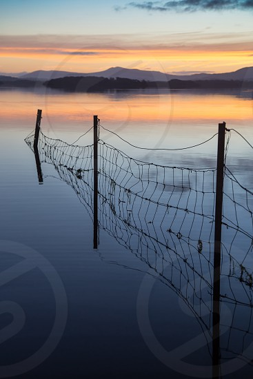 Sunset lake calm reflection reflections colour fence Sky cloud clouds Ireland Kerry Killarney lough water tourism sunrise travel mountain mountains silhouette evening morning beautiful  photo