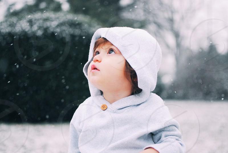 child in white hoodie photo