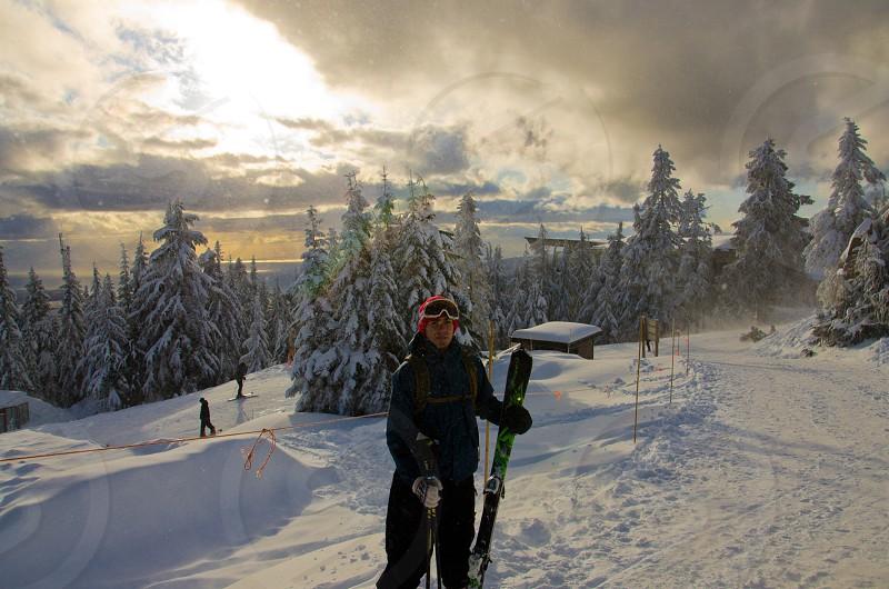 man holding ski photo