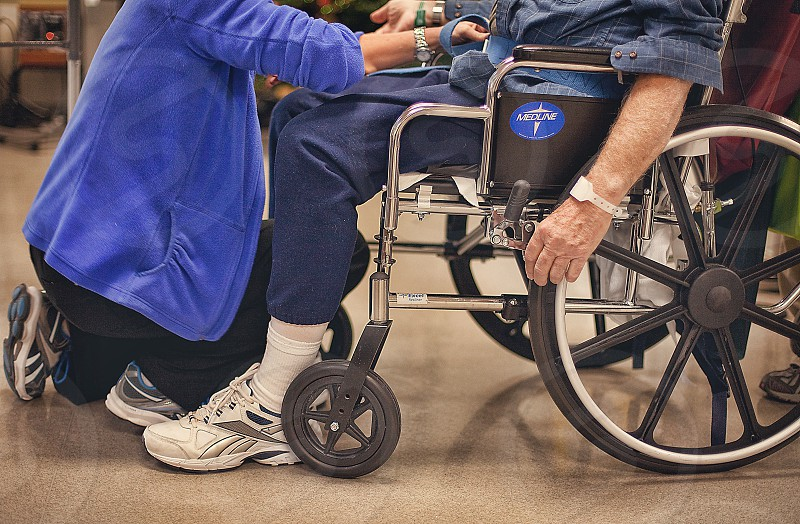 A physical therapist works with a stroke patient at a rehab facility. photo