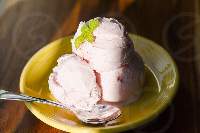 Stawberry ice cream mint leaf yellow plate photo
