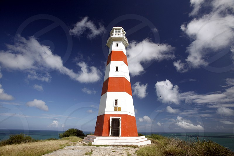 a lighttower at the Coast at the beach Playa Pedro Gonzalez in the town of Pedro Gonzalaz on the Isla Margarita in the caribbean sea of Venezuela. photo