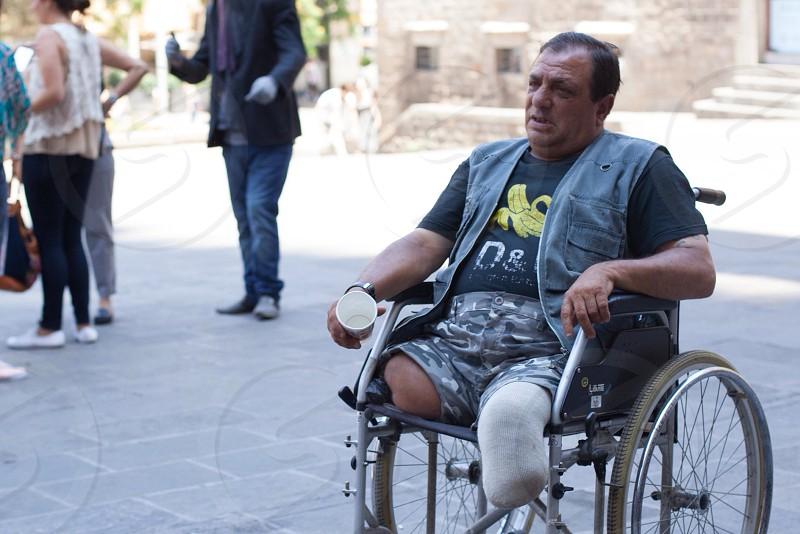 man sitting on wheel chair photo