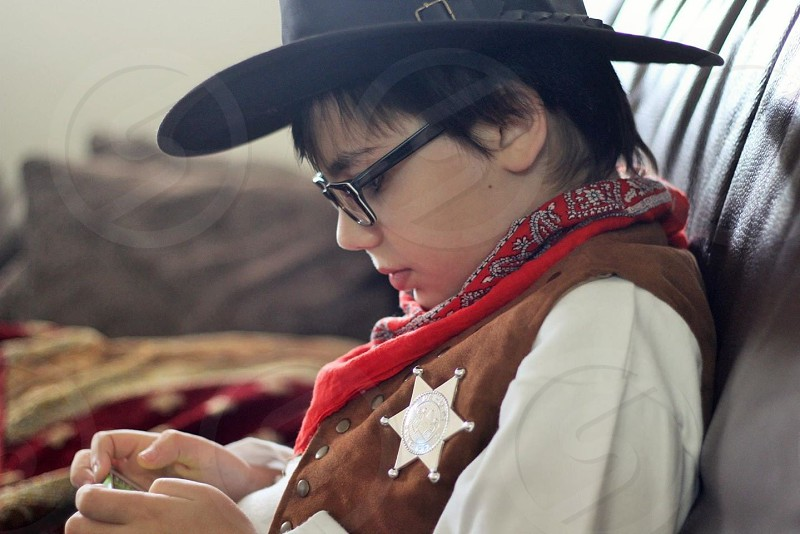 view of a boy wearing cowboy costume photo