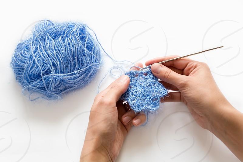 knittingknitedhandsxmasstarsblue photo