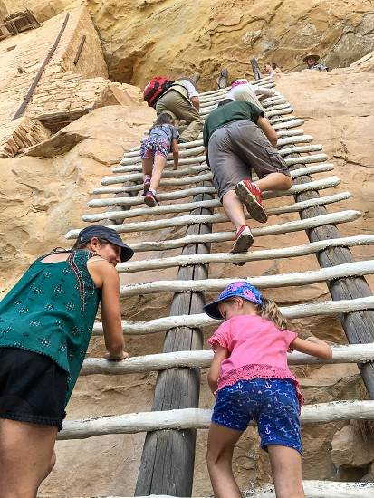Climbing the wooden ladders at Mesa Verde photo