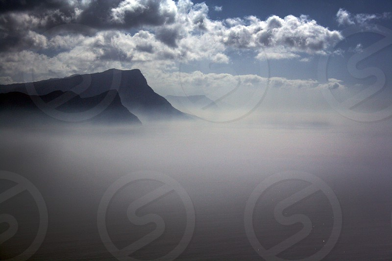 mountain range over stratus clouds view photography photo