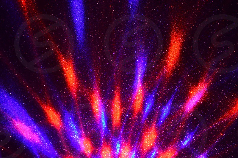 Red blue light. Elegant holiday background. Glossy purple wallpaper. Brilliant night lights. Violet abstract background photo