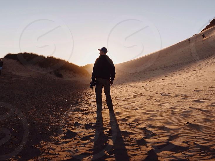 man in black jacket standing photo