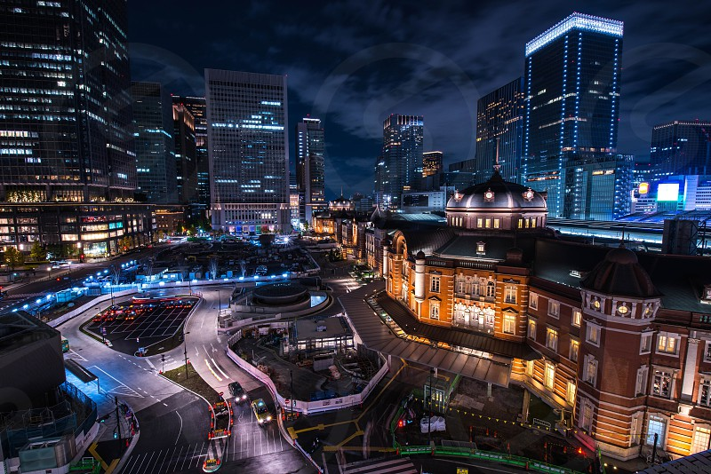 time lapse photography of city road and building during nighttime photo