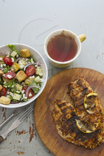 Grilled Fish Salad Tea Dishes food lunch dinner brunch healthy eating fork knife salad in bowl cup organic only at Snapwire photo