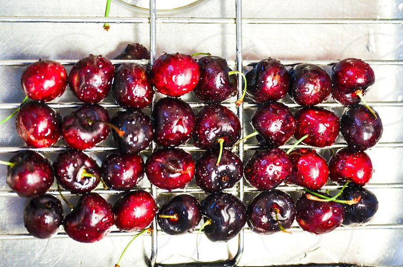 Rounded red cherries on kitchen sink photo