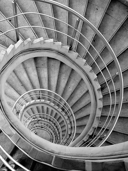 grey spiral concrete stairs photo