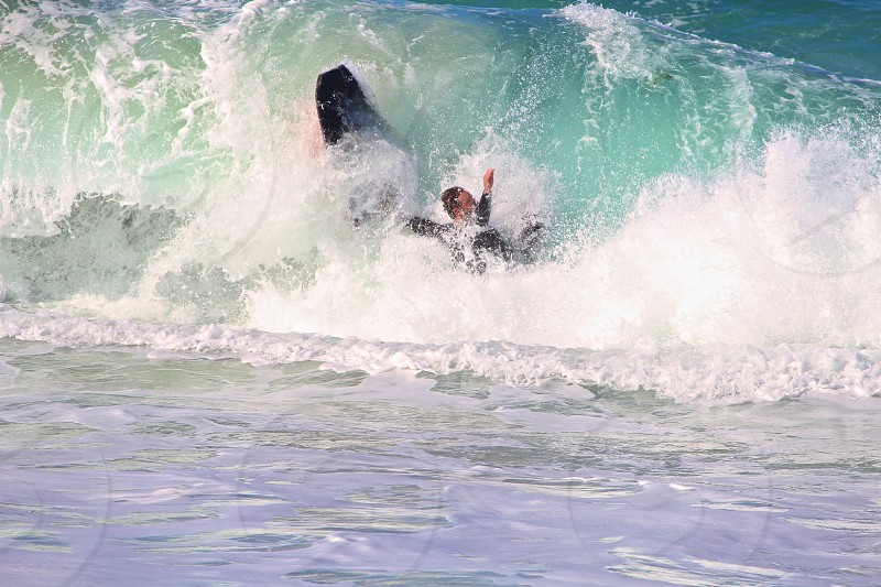 surfer caught on a wave photo