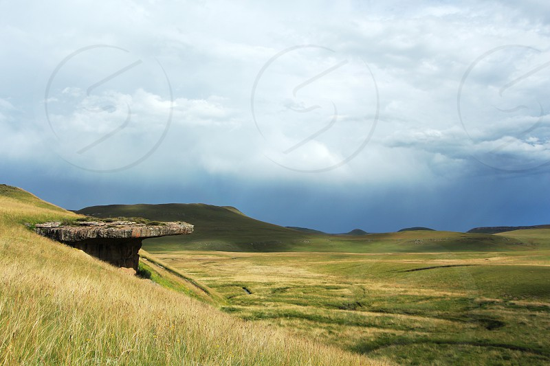 Beautiful scenery with a coming storm in the back. (Location: Drakensberg mountains in South Africa Lesotho.) photo