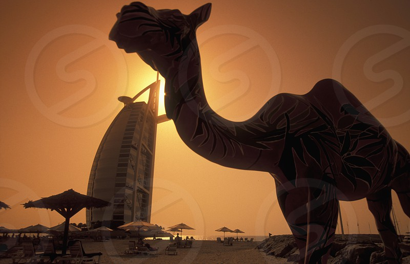 the hotel Burj al Arab in the city of Dubai in the Arab Emirates in the Gulf of Arabia. photo