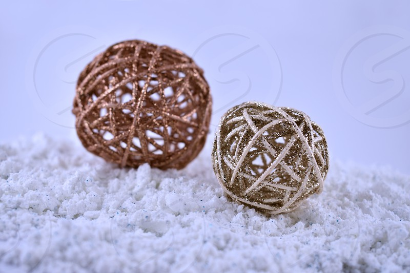 Christmas wicker balls in the snow. Wicker Christmas ornaments images. Christmas decoration on a blue background. Natural home decoration photo