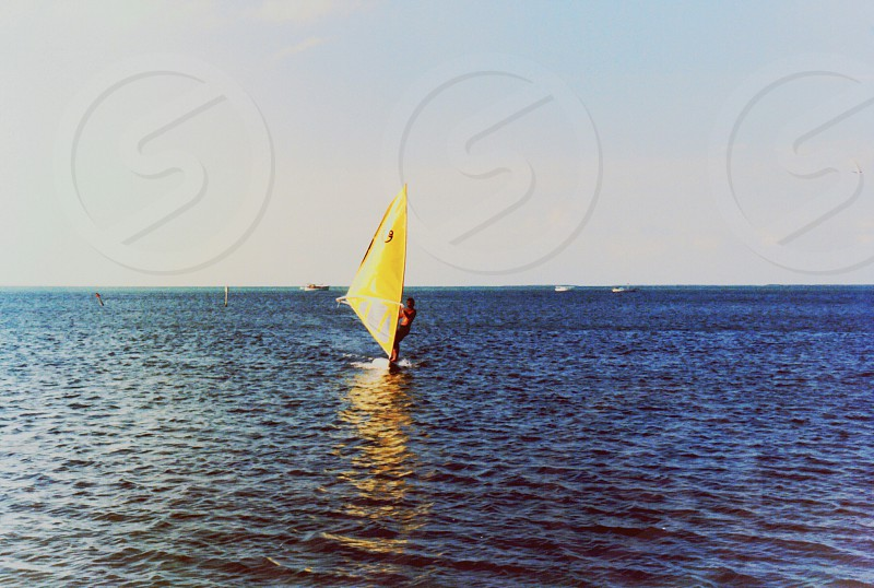 Wind surfer powered by the wind on calm ocean. photo