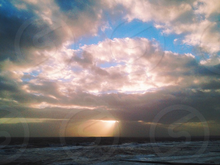 white clouds and ocean photography photo