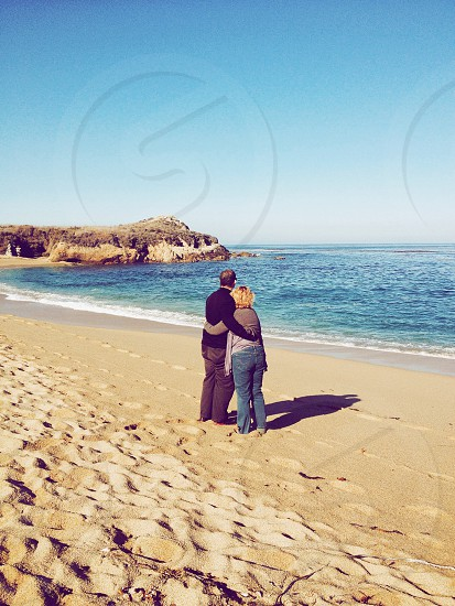 couple hugging at the beach photo
