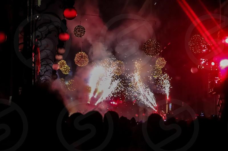 New Year in Palma de Mallorca - street celebration red lights and firewoks photo