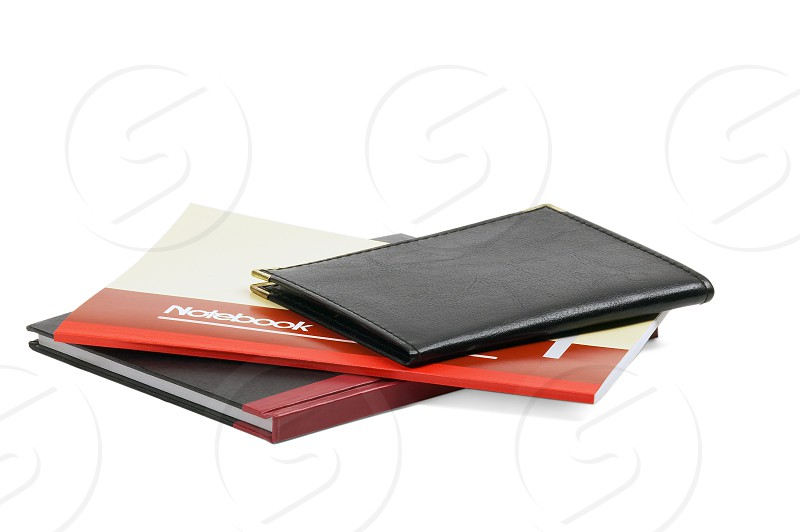assorted notebooks flat piled on white background photo