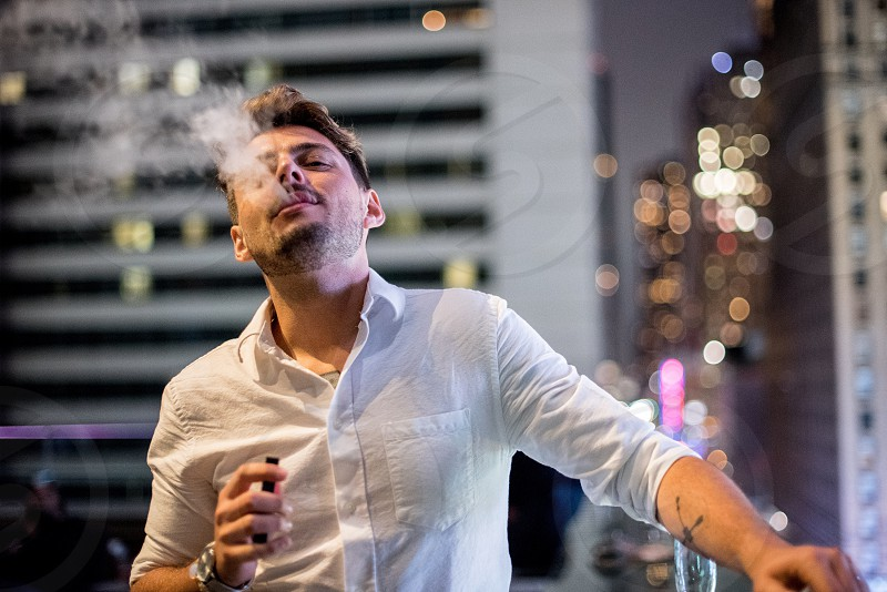 Smoking his electronic cigarette in New York photo