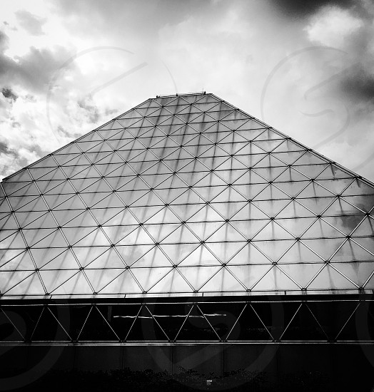 Architexture - glass pyramid with perfect symmetry.  Glass pyramid black and wanted straight lines triangles shapes reflection  photo