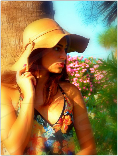 girl in hat spring flowers photo