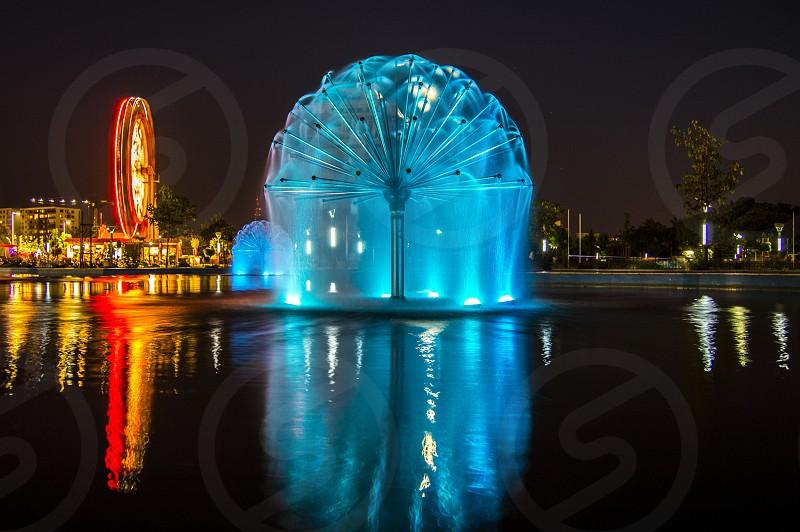 night lights city lake fountain photo
