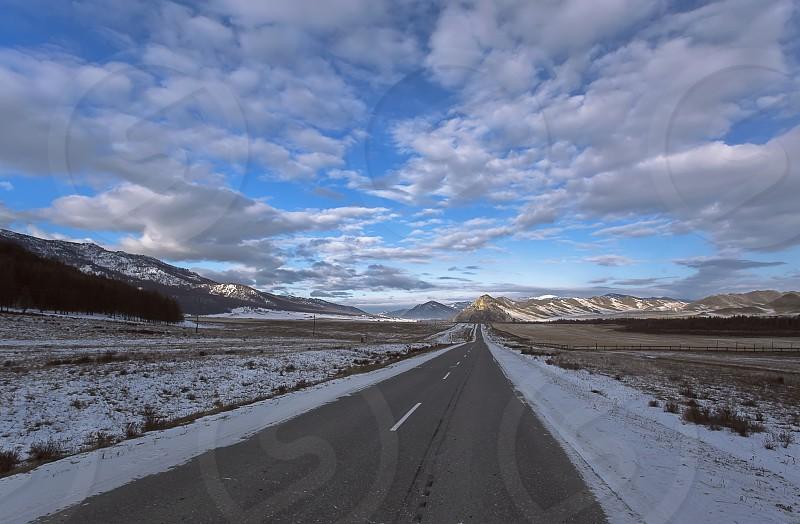 Winter travel on mountain road Russia Siberia Altai photo