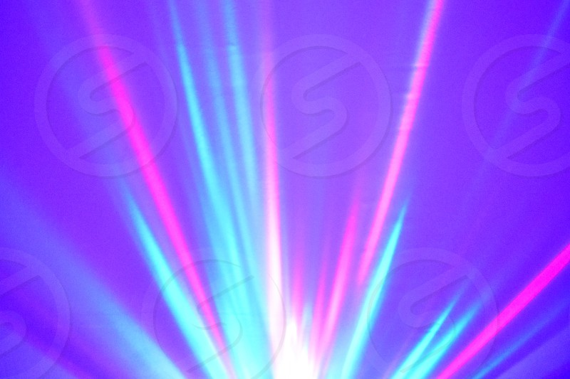 Pink blue light. Elegant holiday background. Glossy purple wallpaper. Brilliant night lights. Violet abstract background. Glowing light party photo