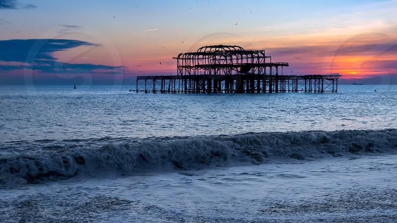 BRIGHTON EAST SUSSEX/UK - JANUARY 26 : View of the derelict West Pier in Brighton East Sussex on January 26 2018 photo